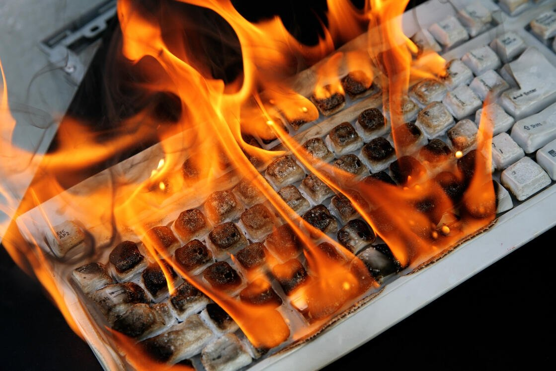 A computer on fire because of PrintNightmare