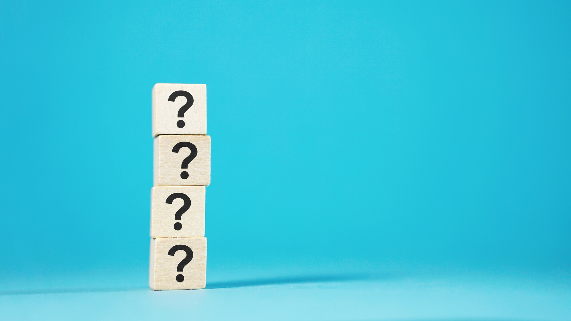 four question marks representing four questions about managed IT support