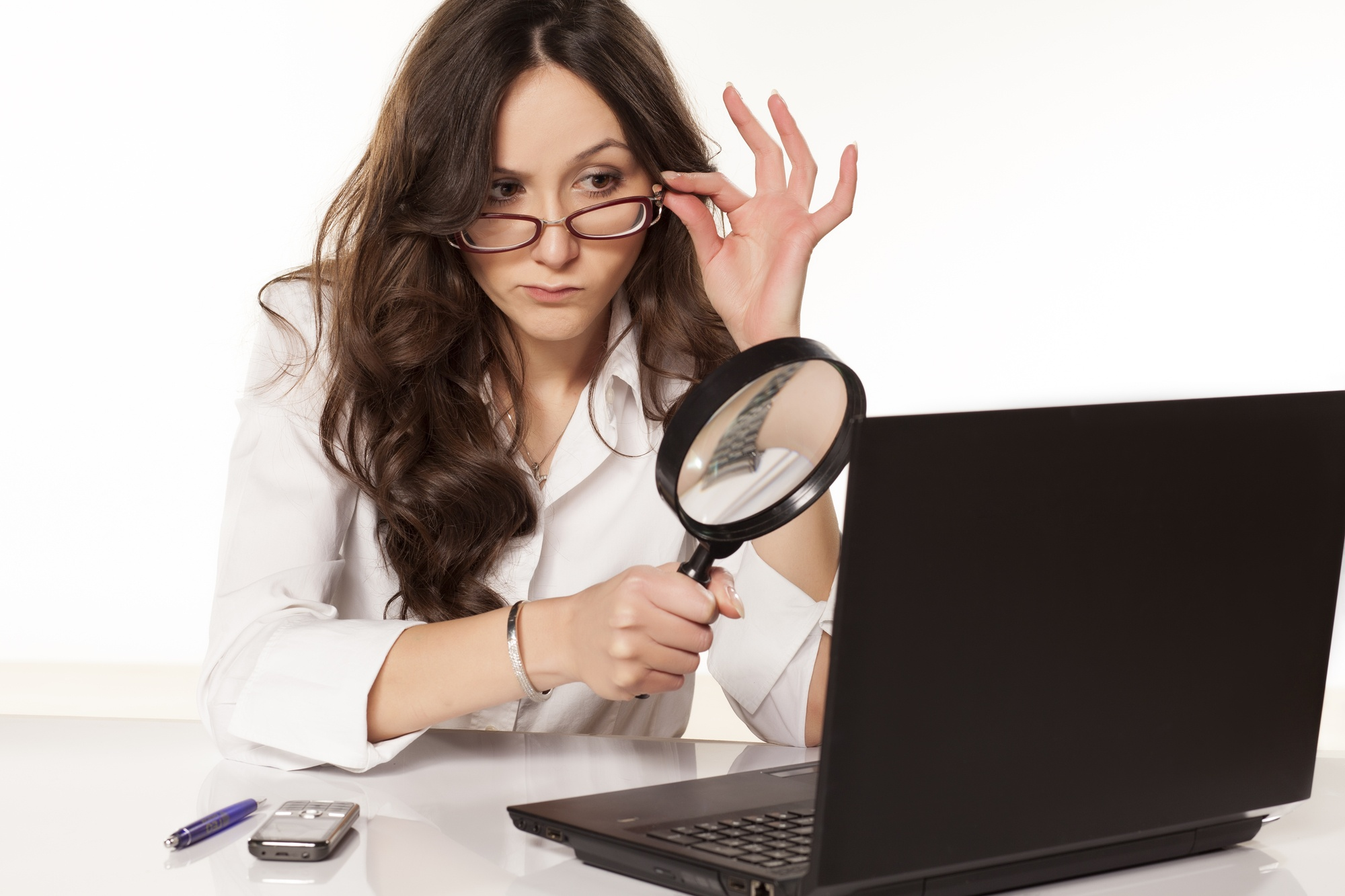 Business woman examining the results of her fully managed IT services